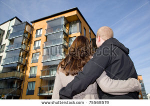 stock-photo-young-couple-dreaming-of-a-new-home-75568579